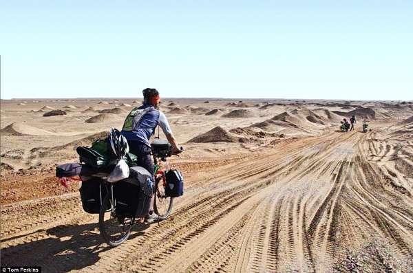 南非男子骑行2万公里游世界寻美食奥莱美食节北国图片