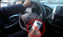 海口治理开车打手机难在哪?