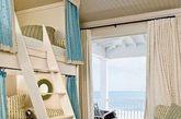 设计重点:阳光海景房设计    编辑点评:将大海朝向的房子做成了儿童房,宽敞的阳台上还能够摆放浪漫的摇椅。房间的布置也随之设计成海洋与沙滩想贴切的颜色,乍一看,与室外的大海似乎融为一体。很是和谐舒适。(实习编辑:刘嘉炜)