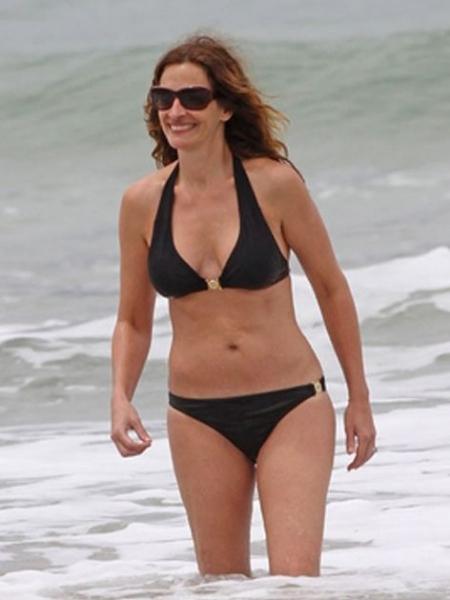 清凉泳装最受宠 众女星示范海滩比基尼