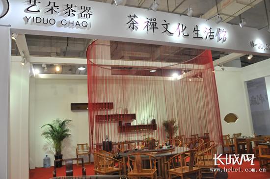 原标题:木石结合茶桌:第二届茶博会上的