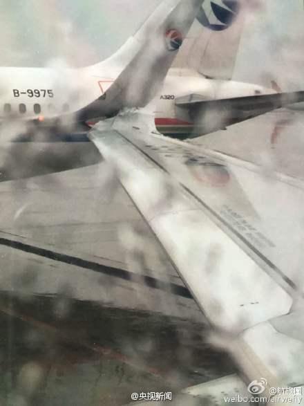 上海虹桥机场两客机机翼碰擦 乘客被疏散