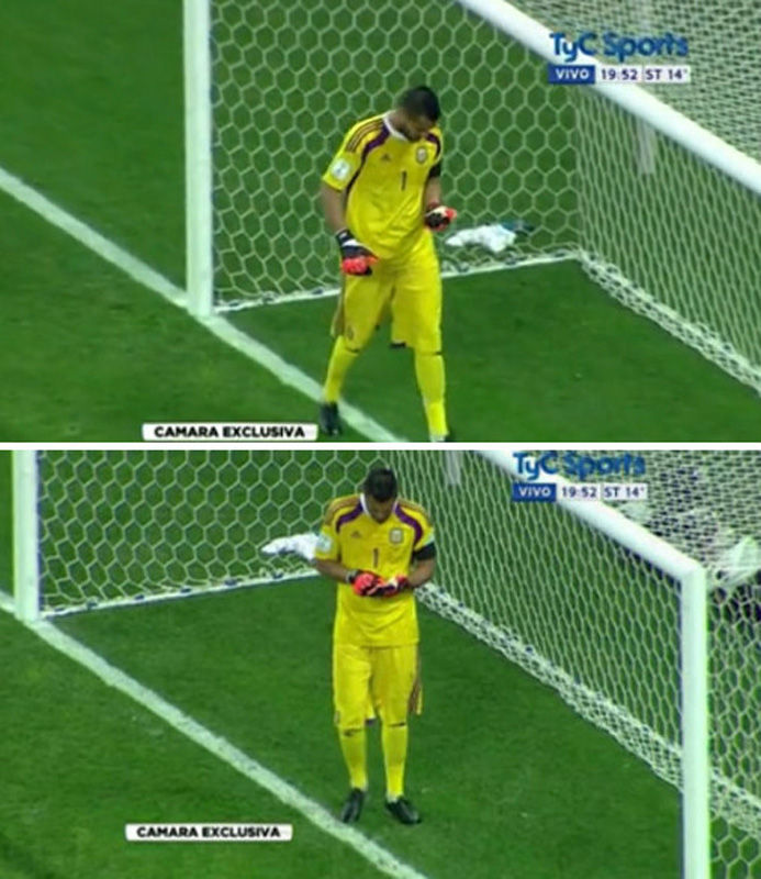 """细心的球迷能够注意到,每次站到门线前,罗梅罗都会查看短裤里的这张小纸条,看完以后,再次塞进短裤。这个小细节让荷兰的罚球队员颇为迷惑。赛后,阿根廷主帅萨维利亚承认,这张纸条上写有荷兰队员习惯性的罚点球方向。罗梅罗说:""""他们告诉我的是,对手更擅长往哪个方向射门。""""图为罗梅罗走上门线前,在认真看一张小纸条。"""