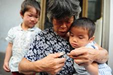 蜜儿餐受益家庭王小芬和她的孩子们