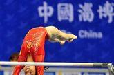 2012年4月7日,2012年国际体联体操世界杯(淄博站)比赛揭幕,姚金男获得高低杠和平衡木两项第一,程菲列在跳马第二,陈一冰排在吊环第二,滕海滨与冯喆分列鞍马和双杠首位。图为姚金男在比赛中。