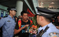中国羽毛球队返京 林丹李永波被围堵