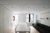 位于纽约市的沙利文街(Sullivan  Street),Graham Hill在零九年花费近29万美元购买了这间近40平米的公寓,并采用罗马尼亚学生Catalin Sandu和Adrian Iancu的方案耗费近37万美元将其改造成了如今这个价值百万的公寓 。通过各种巧妙设计,主卧床和一张可容纳12人就餐的餐桌可以在必要时隐藏、折叠,变身成为简约的客厅或家庭办公室;一扇可移动的墙壁沿着轨道滑开来,可以将整个空间一分为二,从而多出一间拥有两张睡床的客卧,让每一寸空间都极尽其用。(实习编辑:江冬妮)