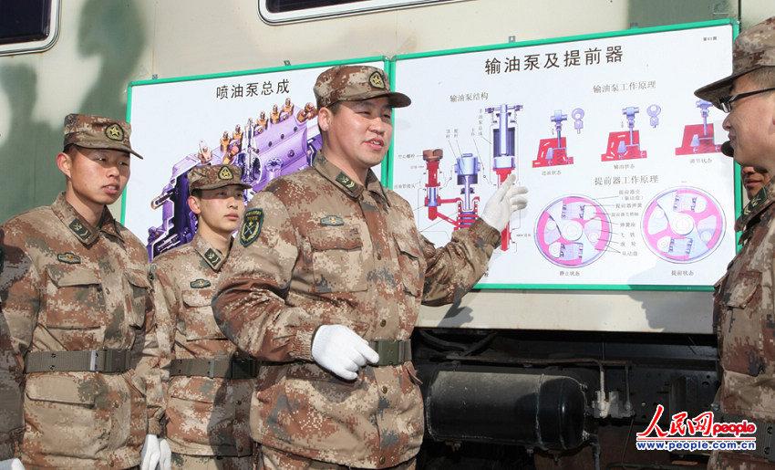 """2月15日,该旅""""优秀士官标兵"""",""""红旗车驾驶员""""——汽车一连四级军士长"""