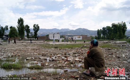 """资料图:当地时间2012年5月1日,巴基斯坦阿伯塔巴德,恐怖组织""""基地""""领袖拉登去年5月2日遭美军海豹突击队击杀,拉登生前住所已被巴基斯坦政府完全拆除。图片来源:CFP视觉中国"""