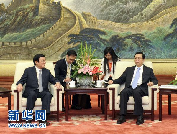 6月20日,全国人大常委会委员长张德江在北京人民大会堂会见越南国家主席张晋创。新华社记者 张铎 摄