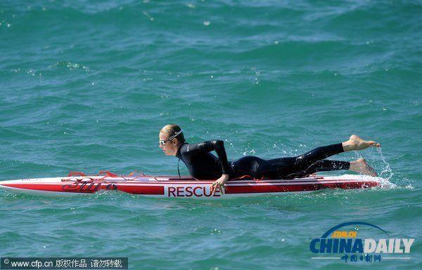 摩纳哥夏琳王妃亲自下海 泳将宣传水上安全意识(组图)